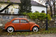 orange volkswagen beetle - stock photo