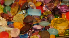 Man fingers touch and sort out natural gemstones 4k Stock Footage