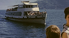 Lake Maggiore 1968: boat arriving at the port Stock Footage
