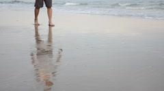 Thai man walking on Hat Chao Samran beach of sea in Phetchaburi Thailand Stock Footage