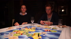 Women playing board game Stock Footage