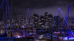 Vancouver holiday boats time lapse night. Condos in the background. Stock Footage