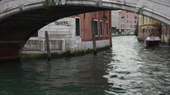 Venice Italy water taxis pass under bridge 4K 017 Stock Footage
