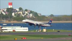 USAirways Embraer airplane taking off Stock Footage