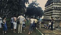 Sri Lanka 1982: european tourists visiting archeological site Stock Footage