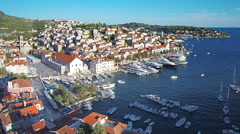 Hvar harbour from aerial drone overhead with church 12 - stock footage