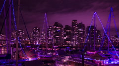 Vancouver party boats time lapse night. Purple and pink tint added. Stock Footage
