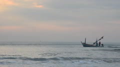 Fishing boat on the sea in m sunrise time at Hat Chao Samran beach Stock Footage