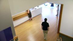 Stock Video Footage of Overhead Shot of Man Walking In Office