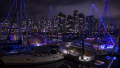 Vancouver boats with holiday lights. Time lapse at night. Stock Footage