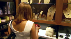 Women Looking At Purse in Boutique Store Stock Footage