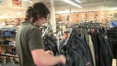 Guy Looking at Harley Jacket Stock Footage
