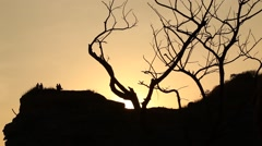 Silhouette of people on the hill Stock Footage