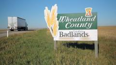 Wheatland County and Canadian Badlands sign in Alberta, Canada. Truck passes. Stock Footage