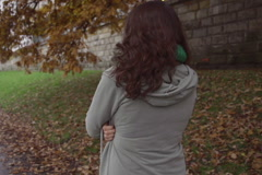 Woman walking on boulevard on gloomy day, steadycam, slow motion shot at 240fps Stock Footage