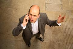 man having argument on the phone. - stock photo