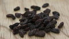 Juicy Raisins on Wood Background - stock footage