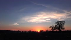 Sunset dusk red sky clouds rural oak trees evening time lapse nature background Stock Footage