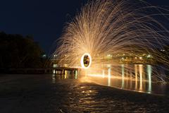Steel Wool Spinning 30 second exposure - stock photo