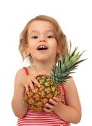 Girl and pineapple. Stock Photos