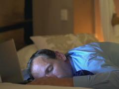 Young businessman sleeping after work on bed at home NTSC Stock Footage