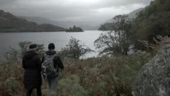 Walking couple Loch Lomond, healthy outdoors Scotland Adventure Stock Footage