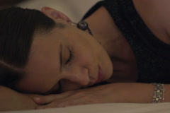 Young woman sleeping on comfortable bed NTSC Stock Footage