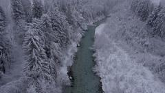 Aerial - River through the winter forest at a light snowing Stock Footage