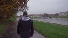 Man walking on boulevard on wintry day, steadycam shot, slow motion shot Stock Footage