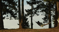 Mother and child in hammock Stock Footage