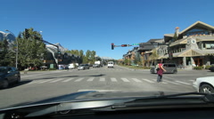 POV Driving in Canmore, Alberta. Mountains in background. - stock footage