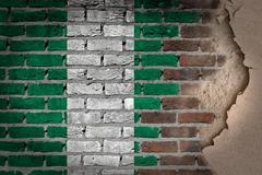Dark brick wall with plaster - nigeria Stock Photos