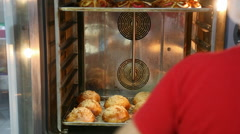 Woman closes the door of the oven Stock Footage
