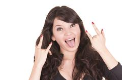 Beautiful playful girl gesturing rock and roll Stock Photos