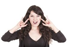 beautiful playful girl gesturing rock and roll - stock photo