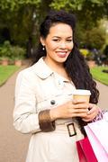 woman enjoying coffee with shopping bags. - stock photo