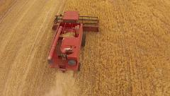 Aerial footage of Harvester fly pass Stock Footage