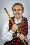 pipe player in traditional clothing - stock photo