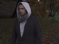 Man with hood walking on pathway, steadycam shot, slow motion shot Stock Footage