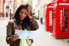 Young woman lost in london Stock Photos