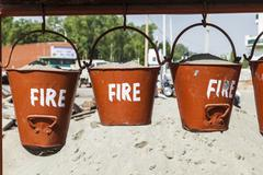 Bucket with sand in a petrol station for fire fighting Kuvituskuvat