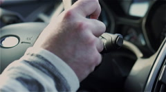 Man hands holding wheel and driving a car, steadycam shot Stock Footage