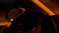 Person driving a car at night and having a trip, steadycam shot - stock footage