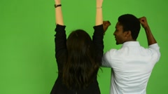 Happy couple rejoice - black man and asian woman - green screen studio Arkistovideo