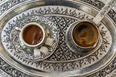 Traditional turkish coffee in traditional silver cup with silver pot and tray Stock Photos