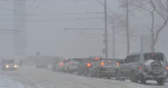 ODESSA - DECEMBER 29: Hard snow storm in the city with slow road traffic on Stock Footage