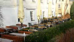 Restaurant in the city - outdoor seating - river and nature Stock Footage