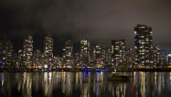 Vancouver condos time lapse night sky. False creek and boat in the foreground. Stock Footage
