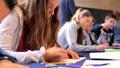 Young people drawing in school class of art - stock footage