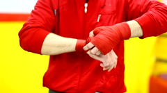 Professional fighter puts bandage on the hand before training Stock Footage